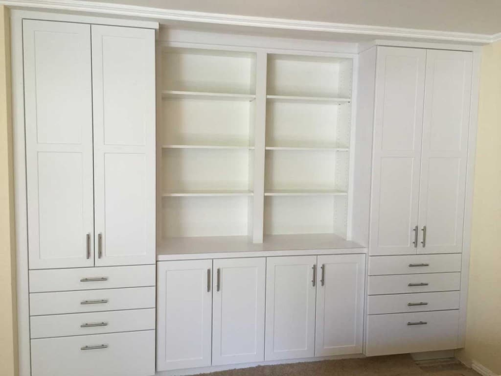 CUSTOM BUILT-IN WHITE CABINETS WITH CLOSETS & SHELVING